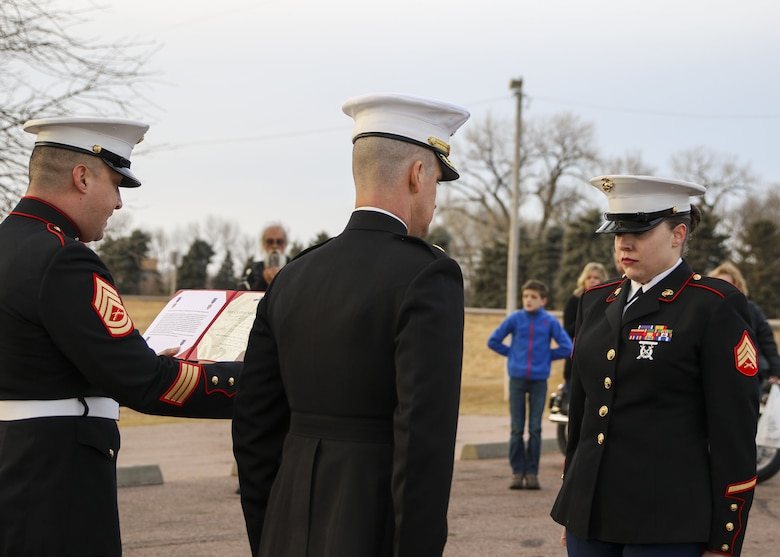 Sergeant Sara McGaffee, a Sioux Falls, S.D., native, receives a Purple Heart Medal, Dec. 16, in front of a detail of Marines and her local friends and family. On Oct. 20th, 2010, while deployed with Combat Logistics Battalion 3, McGaffee's vehicle was hit by an improvised explosive device while conducting convoy operations in support of Operation Steel Dawn II in the Helmand province of Afghanistan.