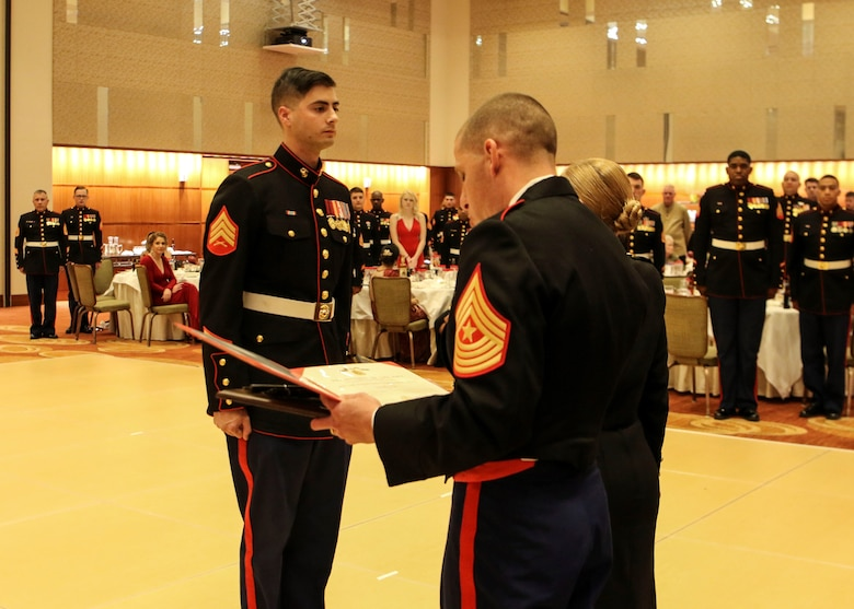 Sgt. Jonathan Orlando stands at attention before receiving his award during the 242nd Marine Corps Birthday Ball at Lumiere Place Casino and Hotel, St. Louis, Missouri, Nov. 10. Orlando, recruiter with Recruiting Sub Station Morris, was awarded the RS Rookie Recruiter of the Year 2017 for Marine Corps Recruiting Command, Recruiting Station St. Louis. (US Marine Corps photo by Cpl. Harley Robinson)