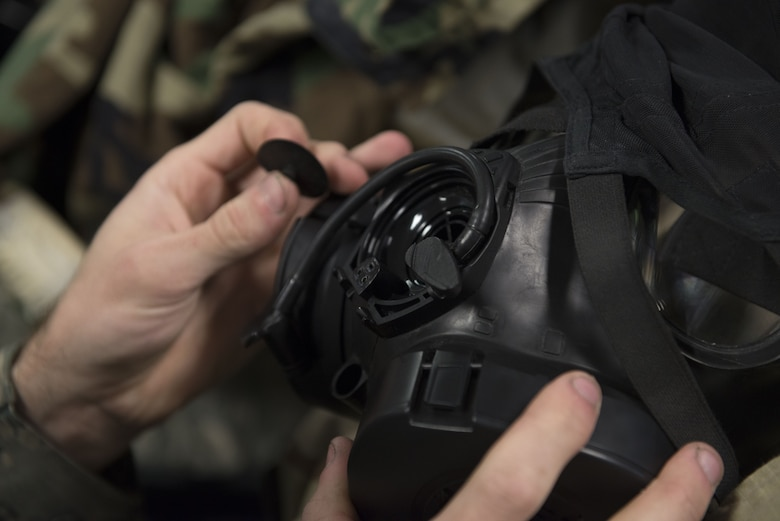 A 366th Fighter Wing Airman checks the inlet/outlet disk valve on his gas mask during chemical, biological, radiological, nuclear and explosives training Dec. 20, 2017, at Mountain Home Air Force Base, Idaho. CBRNE training prepares Airmen to survive and work in a harmful environment anywhere in the world. (U.S. Air Force photo by Airman 1st Class JaNae Capuno)