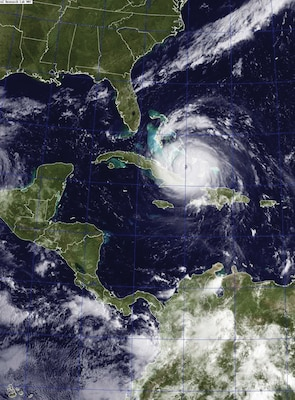 A satellite image from September 7, 2017 shows Hurricane Irma (center) and Hurricane Jose (right) in the Atlantic Ocean and Hurricane Katia in the Gulf of Mexico. (U.S. Navy)