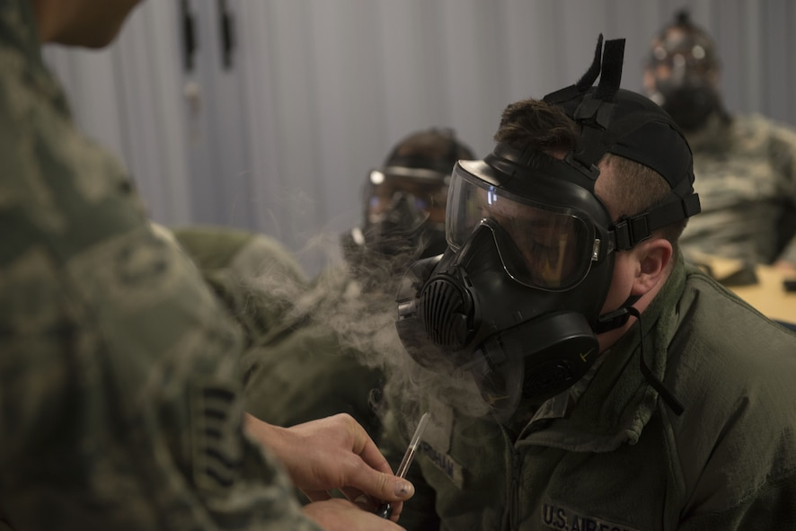 A 366th Fighter Wing Airman undergoes mask confidence training during chemical, biological, radiological, nuclear and explosives training Dec. 20, 2017, at Mountain Home Air Force Base, Idaho. CBRNE training prepares Airmen to survive and work in a harmful environment anywhere in the world. (U.S. Air Force photo by Airman 1st Class JaNae Capuno)