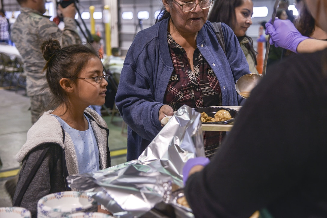 Members of the community surrounding Kirtland are served a full holiday meal at the annual Operation Holiday Cheer event on Dec. 20 at Kirtland Air Force Base, New Mexico. This event is hosted by the Kirtland Fire Department for underprivileged families. Children get to visit with Santa leave with a gift.