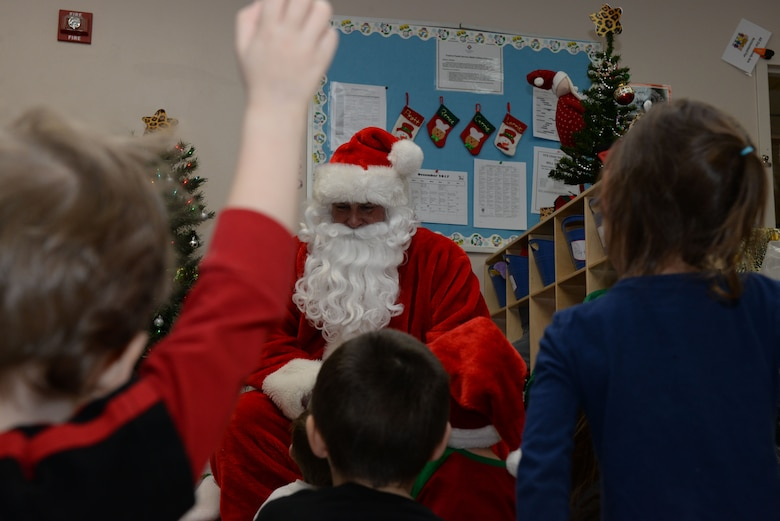Children ask Santa questions inside the Youth & Family Services Child Development Center, in Rapid City, S.D., Dec. 19, 2017. Coordination between the YFS and 28th Operations Group began months in advance to ensure a smooth day of delivering presents and Christmas cheer to children and their families. (U.S. Air Force photo by Airman 1st Class Nicolas Z. Erwin)