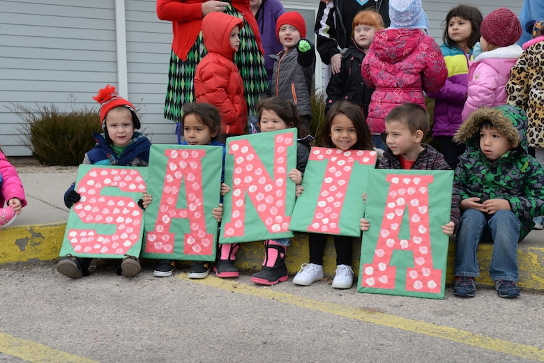 Children and families eagerly wait for Santa to arrive at the Youth & Family Services Child Development Center in Rapid City, S.D., Dec. 19, 2017.  The 28th Operations Group collected and delivered 175 gifts for the annual toy drive. (U.S. Air Force photo by Airman 1st Class Nicolas Z. Erwin)