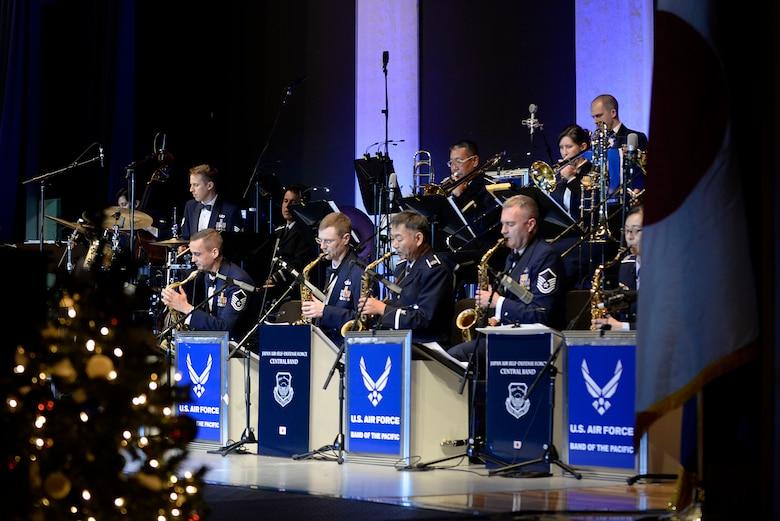 Members of the U.S. Air Force Band of the Pacific and Koku Jietai Central Band, perform at the Sounds of the Season concert, Dec. 19, 2017, at Yokota Air Base, Japan.