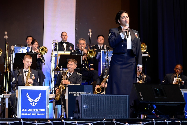 U.S. Air Force Senior Airman Alycia Cancel, U.S. Air Force Band of the Pacific vocalist, sings lead during the Sounds of the Season concert, Dec. 19, 2017, at Yokota Air Base, Japan.