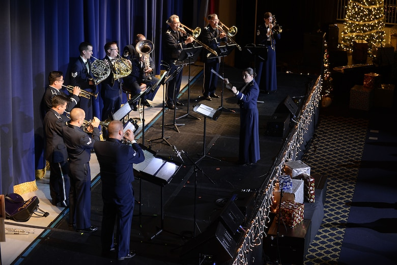 U.S. Air Force Lt. Col. Cristina Moore Urrutia, U.S. Air Force Band of the Pacific commander, conducts members of the PACAF Band and Koku Jietai Central Band during the Sounds of the Season concert, Dec. 19, 2017, at Yokota Air Base, Japan.