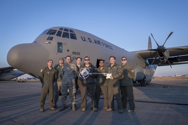 Members of the C-130J Super Hercules number 8605 delivery team pose for a photo, Dec. 21, 2017, at Yokota Air Base, Japan.