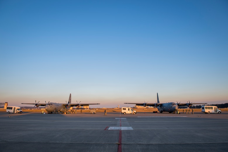 Two C-130J Super Hercules sit on the flightline, Dec. 21, 2017, at Yokota Air Base, Japan.