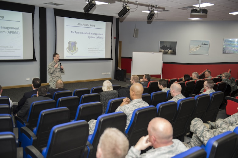 Col. Lee Williames, 48th Medical Group commander, speaks to members of the U.K. National Health Service, 48th MDG and other first responders during an emergency management orientation and crosstalk event at Royal Air Force Lakenheath, England, Dec. 15. The event's purpose was to provide an opportunity for the attending agencies to discuss the procedures used during major or minor incidents, such as natural disasters, terrorist attacks and car accidents. Members of the U.K. National Health Service, 48th Fighter Wing Medical Group and other first responders discuss major or minor incident scenarios during an emergency management orientation and crosstalk event at Royal Air Force Lakenheath, England, Dec. 15. The EM orientation and crosstalk was the first part of a three-step plan with the final portion being a functional exercise. (U.S. Air Force photo/Tech. Sgt. Emerson Nunez)