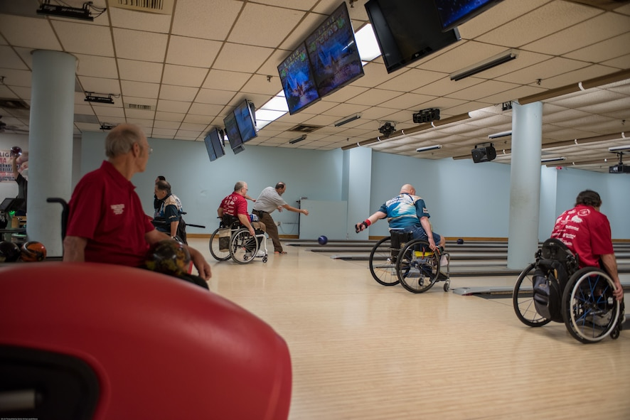 Wounded Warriors and disabled veterans bowl during an event hosted by the Office of the Warrior Advocate at Offutt Air Force Base, Nebraska, Dec. 21, 2017. The adaptive bowling event aimed to strengthen the community of injured active duty service members and veterans the office has been building since it was established in October 2016. (U.S. Air Force photo by Senior Airman Jacob Skovo)