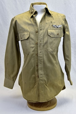 "Plans call for this artifact to be displayed near the B-17F Memphis Belle™ as part of the new strategic bombardment exhibit in the WWII Gallery, which opens to the public on May 17, 2018. 2nd Lt Raymond ""Jack"" Warner wore this shirt during his time as a POW after being wounded and shot down on the August 1943 Ploesti raid."