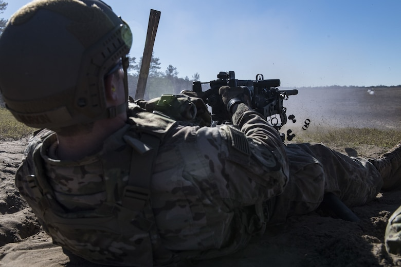 Staff Sgt. Richard Murkin, 823rd Base Defense Squadron fire team member, fires a .50 caliber M2 machine gun during a heavy weapons qualification, Dec. 13, 2017, at Camp Blanding Joint Training Center, Fla. Airmen train with the M2 to maintain their proficiency and remain familiar with the weapon. (U.S. Air Force photo by Senior Airman Janiqua P. Robinson)