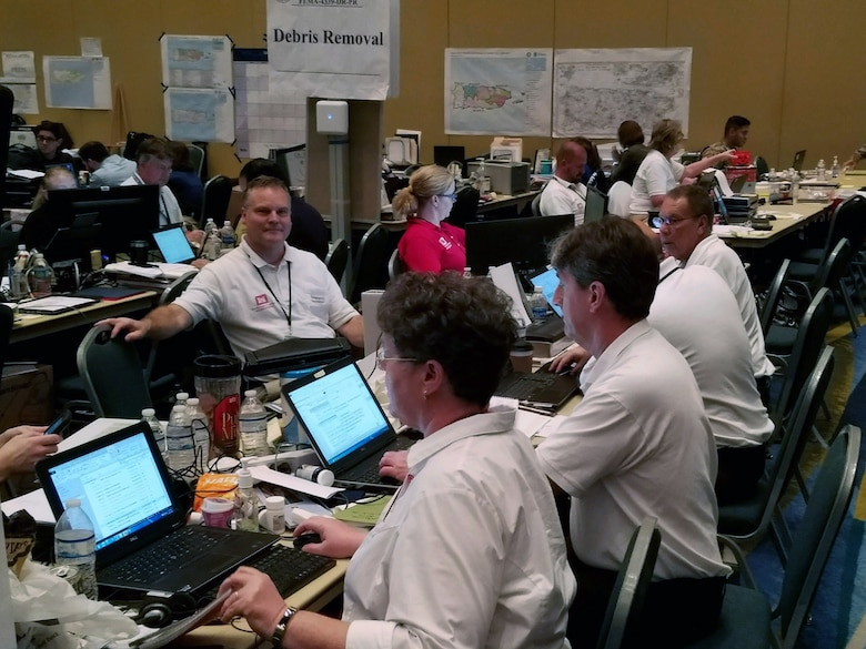 A group of first responders working in an emergency operations center.