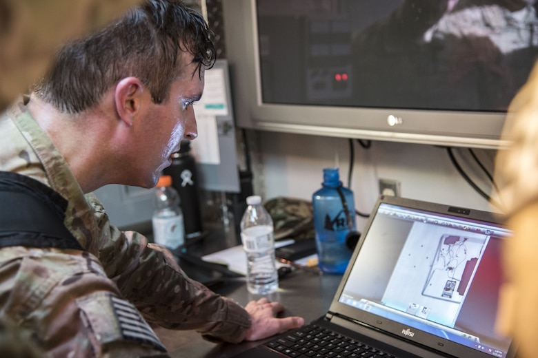 Tech Sgt. Nickolas Adkisson, 23d Civil Engineer Squadron (CES) Explosive Ordinance Disposal (EOD) team leader, examines a computer screen during a response training exercise, Dec. 21, 2017, at Moody Air Force Base, Ga. The EOD Airmen were evaluated on their ability to respond to a distress call, locate, identify and neutralize an improvised explosive device. (U.S. Air Force photo by Airman Eugene Oliver)