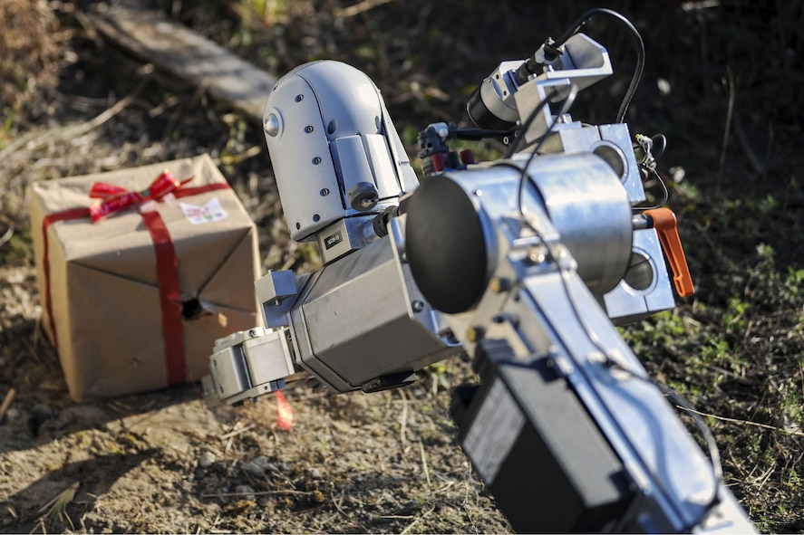 An Air Force medium sized robot approaches a simulated Improvised Explosive Device during a response training exercise, Dec. 21, 2017, at Moody Air Force Base, Ga. The EOD Airmen were evaluated on their ability to respond to a distress call, locate, identify and neutralize an improvised explosive device. (U.S. Air Force photo by Airman Eugene Oliver)