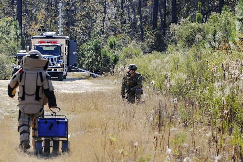 Tech Sgt. Nickolas Adkisson, left, 23d Civil Engineer Squadron (CES) Explosive Ordinance Disposal (EOD) team leader, drags a wagon towards Senior Airman Trenton Broxterman, 23d CES EOD apprentice, during a response training exercise, Dec. 21, 2017, at Moody Air Force Base, Ga. The EOD Airmen were evaluated on their ability to respond to a distress call, locate, identify and neutralize an improvised explosive device. (U.S. Air Force photo by Airman Eugene Oliver)