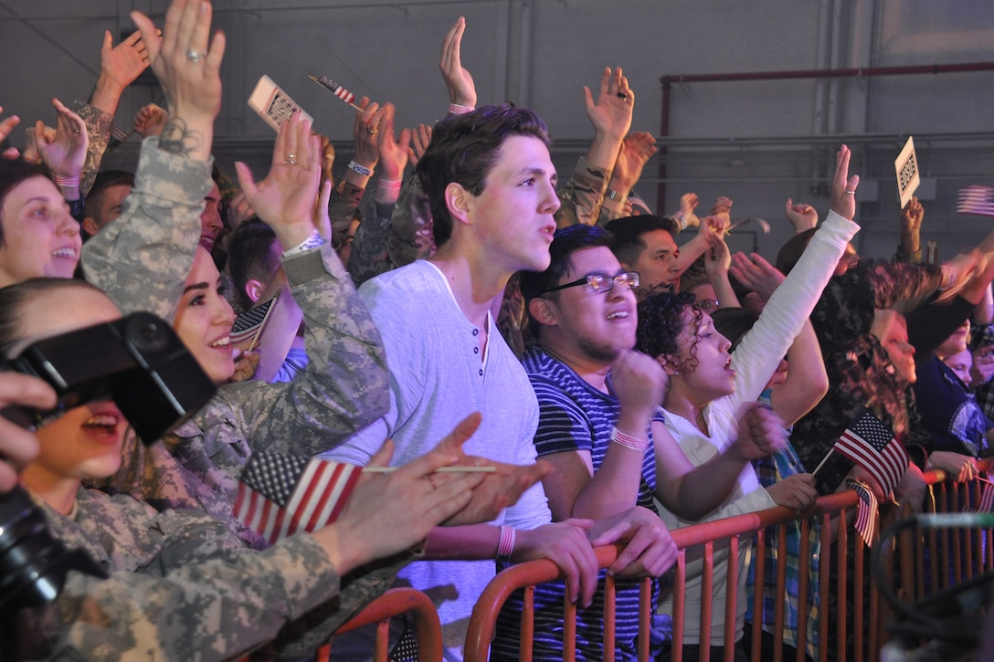 Movie extras watch a concert on the movie set of Pitch Perfect 3, filmed at Dobbins Air Reserve Base, Ga. March 18, 2017. The base was made to look like Rota, Spain. (U.S. Air Force photo/Master Sgt. James Branch)