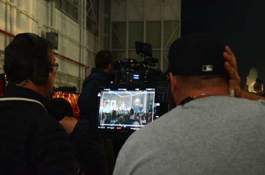 Movie crew members review footage during production of Pitch Perfect 3, filmed at Dobbins Air Reserve Base, Ga. March 18, 2017. The base was made to look like Rota, Spain. (U.S. Air Force photo/Don Peek)