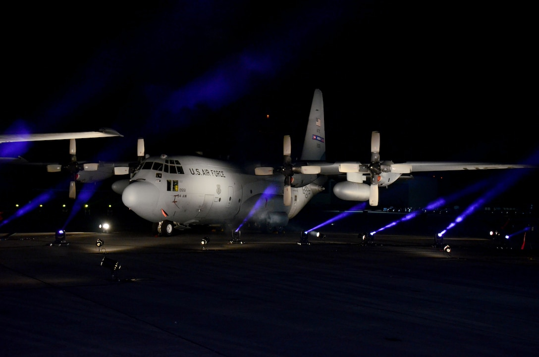 A C-130 Hercules is lit with blue lights on the movie set of Pitch Perfect 3, filmed at Dobbins Air Reserve Base, Ga. March 18, 2017. The base was made to look like Rota, Spain. (U.S. Air Force photo/Don Peek)