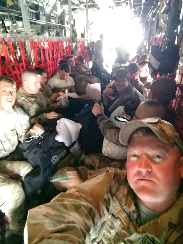 Image of Master Sgt. Christopher Ebeling, 366th Security Forces superintendent of installations security, snaps a selfie with U.S. Air Force Security Forces from various bases on a C-17 Hercules in Djibouti, Africa. The Airmen were headed to Kenya. (Photo courtesy of Msgt. Christopher Ebeling)