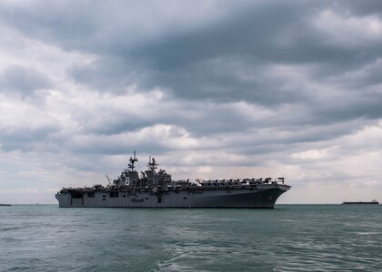 CHANGI, Singapore (Dec. 22, 2017) - The amphibious assault ship USS America (LHA 6) pulls in to RSS Singapura - Changi Naval Base, Singapore during a regularly scheduled port visit Dec. 22. America, part of the America Amphibious Ready Group, with embarked 15th Marine Expeditionary Unit, is operating in the Indo-Asia Pacific region to strengthen partnerships and serve as a ready-response force for any type of contingency.