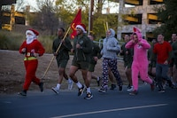 U.S. Marines and Sailors with 7th Engineer Support Battalion, 1st Marine Logistics Group, participate in a battalion holiday run at Camp Pendleton, Calif., Dec. 22, 2017. The Marines and Sailors of 7th ESB wore festive clothing in celebration of the holidays.