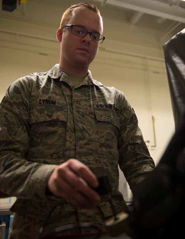 U.S. Air Force Senior Airman David Lynum, 133rd Maintenance Squadron, uses the eddy current bolt hole inspector to find defects within aircraft equipment in St. Paul, Minn., Feb. 26, 2017.