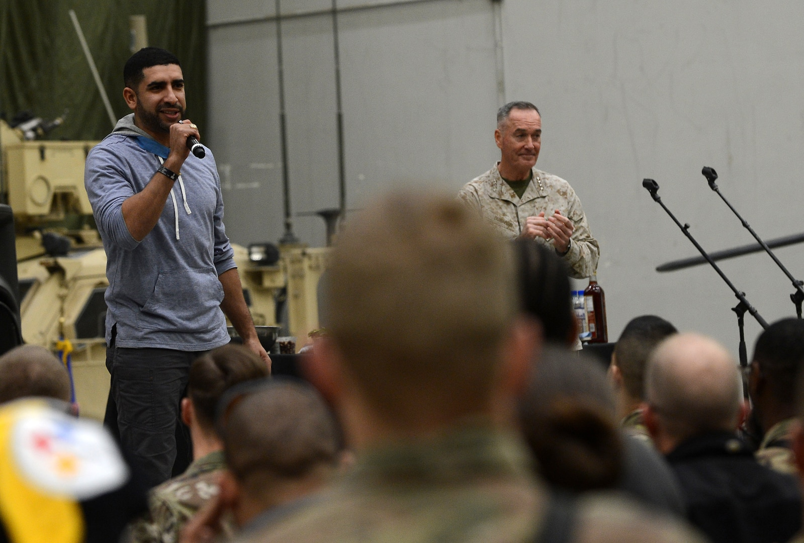 Medal of Honor Recipient Army Capt. (ret.) Florent Groberg, speaks to Bagram Airfield troops during the 2017 Chairman's USO Holiday Tour Dec. 24, 2017 at Bagram Airfield, Afghanistan. Deployed service members, civilians and contractors enjoyed a USO Holiday Tour, featuring actor Adam Devine, comedian Iliza Shlesinger, and WWE Wrestler Alicia Fox, Medal of Honor Recipient Army Capt. (ret.) Florent Groberg, Celebrity Chef Robert Irvine, TNA Wrestler Gail Kim, country singer Jerrod Nieman and WWE wrestler The Miz. (U.S. Air Force photo/Staff Sgt. Divine Cox)