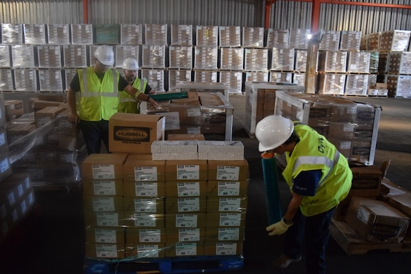 Tons of critical power grid materials arrive daily for housing at the Ponce, Puerto Rico, warehouse, part of the critical electrical components needed to rebuild the island's power grid, Dec. 22, 2017. The Army Corps of Engineers' Task Force Power Restoration team maintains 100-percent accountability of every item, from the smallest electrical component to the 5,500-pound concrete utility pole, until it arrives at the delivery site, is stored and ultimately issued to the workforce. Army Corps of Engineers photo by Gerald Rogers