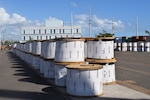 Hundreds of massive coils of heavy high tension wire arrive at the laydown yard in Ponce, Puerto Rico.