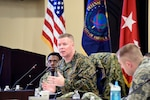 The DIA Command Senior Enlisted Leader Master Gunnery Sgt. Scott Stalker, center, emphasizes readiness across the workforce during an off-site for enlisted military service members, Dec. 18, at Joint Base Andrews, Maryland.