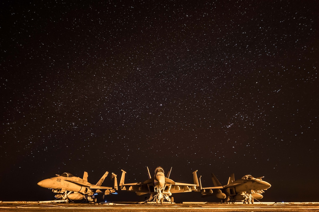 (Dec. 22, 2017) Three aircraft rest on the flight deck of the aircraft carrier USS Theodore Roosevelt (CVN 71). Theodore Roosevelt and its carrier strike group are deployed to the U.S. 5th Fleet area of operations in support of maritime security operations to reassure allies and partners and preserve the freedom of navigation and the free flow of commerce in the region. (U.S. Navy photo by Mass Communication Specialist 3rd Class Spencer Roberts/Released)