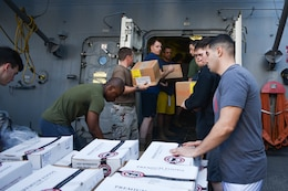 U.S. FIFTH FLEET AREA OF OPERATIONS (Dec. 22, 2017) – Marines and Sailors with USS San Diego and embarked 15th Marine Expeditionary Unit pass boxes during a replenishment at sea. San Diego, with the embarked 15th Marine Expeditionary Unit, is deployed to the U.S. 5th Fleet area of operations in support of maritime security operations to reassure allies and partners and preserve the freedom of navigation and the free flow of commerce in the region.