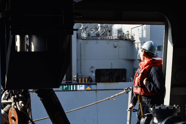 U.S. FIFTH FLEET AREA OF OPERATIONS (Dec. 22, 2017) – A Sailor with USS San Diego observes USNS Washington Chambers during a replenishment at sea. San Diego, with the embarked 15th Marine Expeditionary Unit, is deployed to the U.S. 5th Fleet area of operations in support of maritime security operations to reassure allies and partners and preserve the freedom of navigation and the free flow of commerce in the region.
