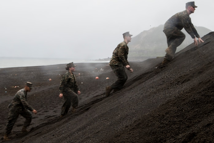 Marines with III Marine Expeditionary Force climb the steep slope of the landing beaches during a trip to Iwo Jima, Japan, Dec. 19, 2017. Marines from across III MEF, the 31st MEU and Marine Corps Installations Pacific, flew some 850 miles east, from Okinawa, Japan, to visit the historic island, now called Iwo To, to tour the battle site and honor the men who fought there in February 1945. (U.S. Marine Corps photo by Staff Sgt. T. T. Parish/Released)