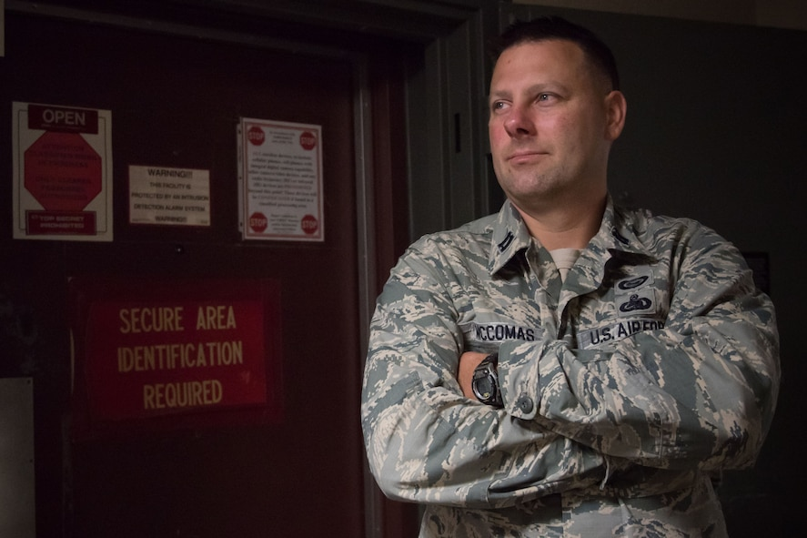 Capt. Paul McComas, 403rd Operations Support Squadron chief of wing intelligence, poses for a photo Aug. 23, 2017 at Keesler Air Force Base Mississippi. He leads a group of intellegence analysts who provide threat briefings before 403rd Wing missions and deployments. (U.S. Air Force photo/Staff Sgt. Heather Heiney)