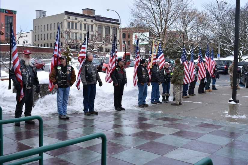 Military veterans display American flags in downtown Glens Falls, N.Y.