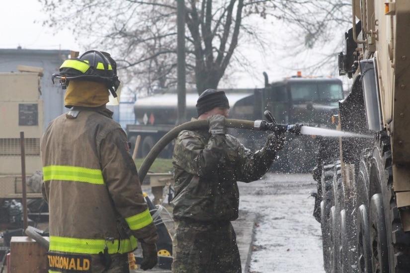 Firefighters from the 23rd Ordnance Company supplement vehicle and equipment cleaning for the 497th Combat Sustainment Support Battalion's customs clearance and agricultural inspections as they prepare to return to the United States in Powidz, Poland.