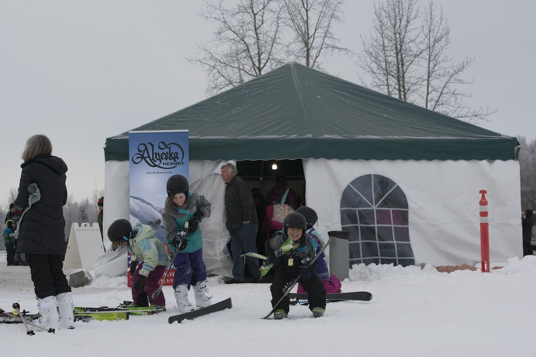 Children put on their skis outside a concessions tent at the Hillberg Ski Area during Winterfest at Joint Base Elmendorf-Richardson, Alaska, Dec. 21, 2017. Winterfest was a winter solstice celebration hosted by Hillberg for anyone with base access and offered a plethora of events from noon to as late at 8 p.m.