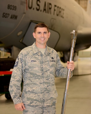 Senior Master Sgt. Corey Still, 507th Aircraft Maintenance Squadron aircraft maintenance unit superintendent, wields a torque wrench while posing for a photo Dec. 20, 2017, at Tinker Air Force Base, Okla. Still provided lifesaving assistance to a motorcyclist following a vehicle accident in November 2017. (U.S. Air Force photo/Tech. Sgt. Lauren Gleason)