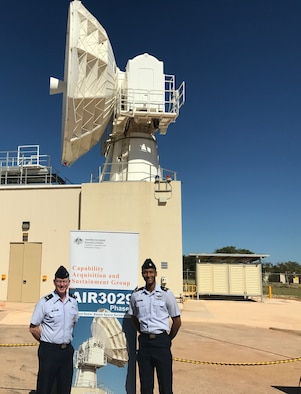 NAVAL COMMUNICATIONS STATION HAROLD E. HOLT, Western Australia, - Col. Troy Endicott, 21st Operations Group commander, left, and Maj. Alfred Maynard, 21st OG Air Force liaison officer, attend a ribbon cutting to commemorate the C-Band Space Surveillance Radar System's attainment of full operational status at Naval Communications Station Harold E. Holt, Western Australia, March 7, 2017. The radar was dissembled, transported and rebuilt in Australia following the deactivation of Antigua Air Station, Antigua, in July 2015, where it was originally located. (Courtesy Photo)