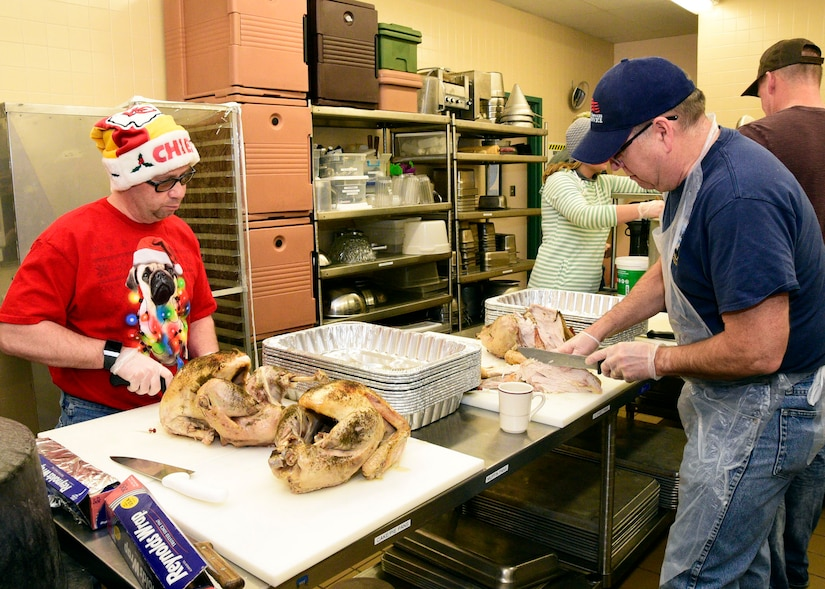 Members of the Montana Air National Guard carve turkeys at the 120th Airlift Wing Dining Facility at the Great Falls International Airport in Great Falls, Montana Dec. 24, 2017. The guard personnel volunteered to prepare 50 turkeys, dressing and gravy and delivered the food to the Great Falls Senior Citizen Center to be served during the 25th Annual Danny Berg Memorial Christmas Dinner. (U.S. Air National Guard photo/Senior Master Sgt. Eric Peterson)