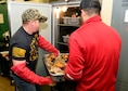 Members of the Montana Air National Guard carry a pan of cooked turkeys to a warming oven at the 120th Airlift Wing Dining Facility at the Great Falls International Airport in Great Falls, Montana Dec. 24, 2017. The guard personnel volunteered to prepare 50 turkeys, dressing and gravy and delivered the food to the Great Falls Senior Citizen Center to be served during the 25th Annual Danny Berg Memorial Christmas Dinner. (U.S. Air National Guard photo/Senior Master Sgt. Eric Peterson)
