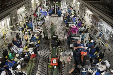 U.S. Air Force Reserve Airmen assigned to the 45th Aeromedical Evacuation Squadron assist patients aboard a C-17 Globemaster III in St. Croix, U.S. Virgin Islands, Sept. 24, 2017, as part of the relief efforts following Hurricane Maria. (U.S. Air Force photo by Tech. Sgt. Peter Dean)