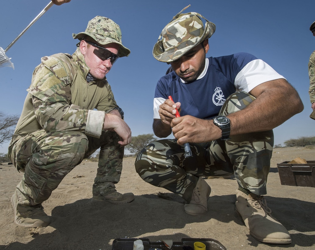 Explosive Ordnance Disposal Technician 3rd Class Ben Holden, left, assigned to Task Group 56.1, and a member of the Royal Navy of Oman prepare explosives during Exercise Safe Handling 2017. (U.S. Navy photo by Mass Communication Specialist 2nd Class Sean Furey)