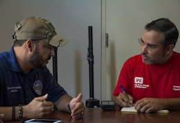 Omar Esquilin-Mangual meets with a local resident while working the Blue Roof mission in Puerto Rico.