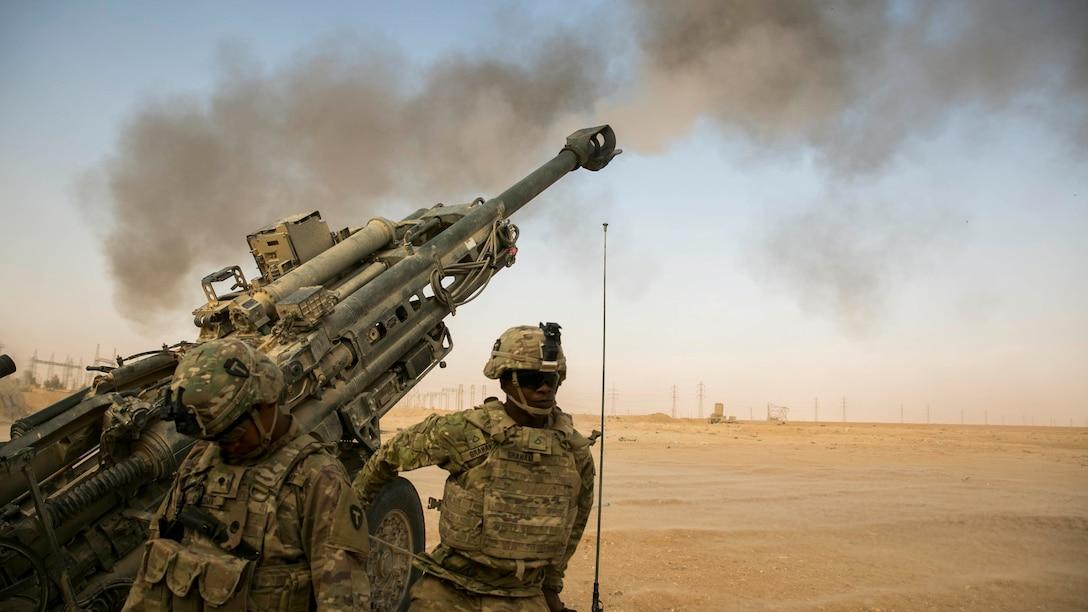 American artillery soldiers respond to a fire mission somewhere in Iraq in support of Combined Joint Task Force Operation Inherent Resolve to provide assistance to their Iraqi partners.