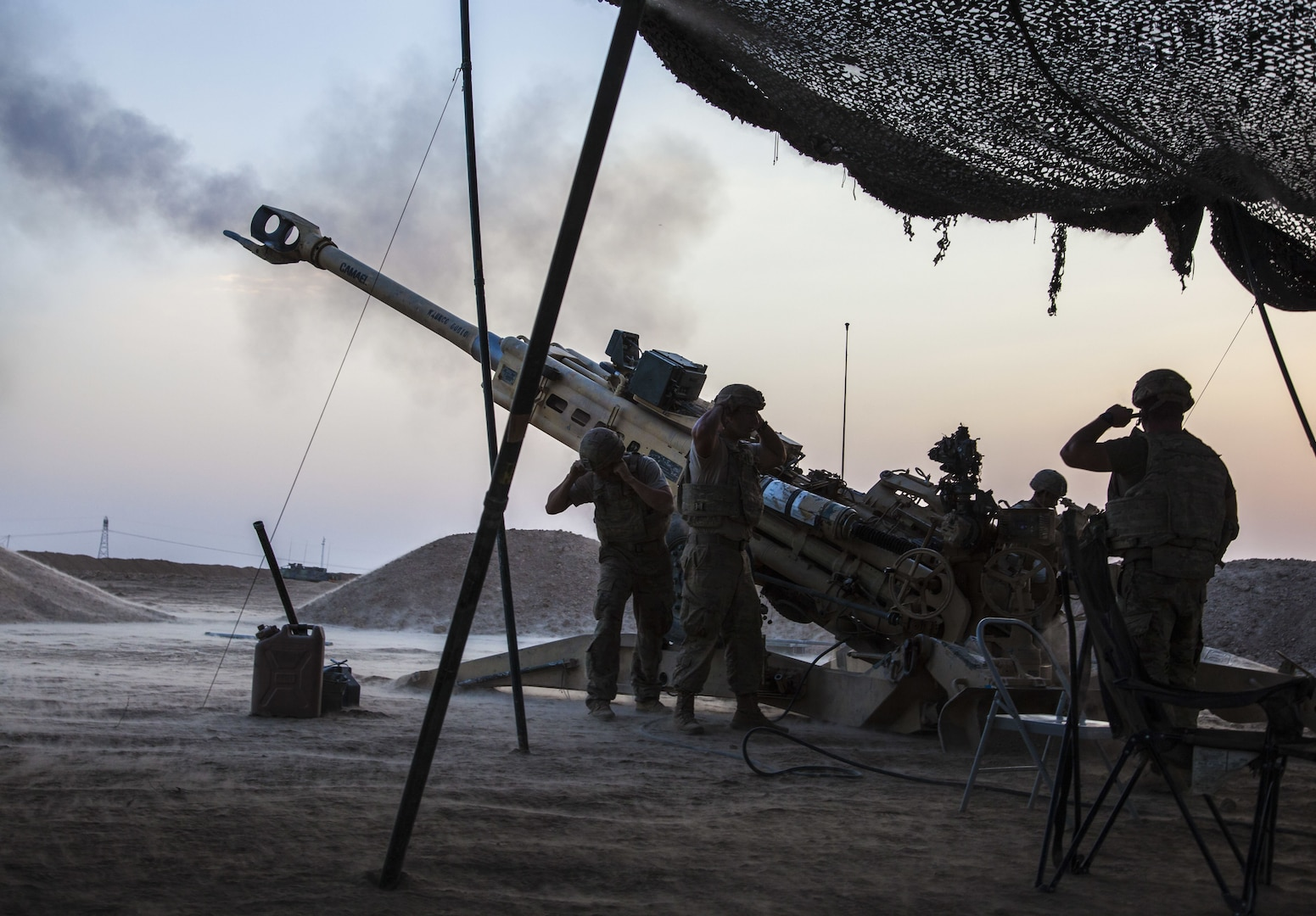 U.S. Army Paratroopers, deployed in support of Combined Joint Task Force – Operation Inherent Resolve and assigned to 2nd Battalion, 319th Airborne Field Artillery Regiment, 2nd Brigade Combat Team, 82nd Airborne Division, fire an M777 towed 155 mm howitzer in support of Iraqi security forces in northern Iraq, August 15, 2017. The 2nd BCT, 82nd Abn. Div., enables Iraqi security force partners through the advise and assist mission, contributing planning, intelligence collection and analysis, force protection and precision fires to achieve the military defeat of ISIS. CJTF-OIR is the global Coalition to defeat ISIS in Iraq and Syria. (U.S. Army photo by Cpl. Rachel Diehm.)