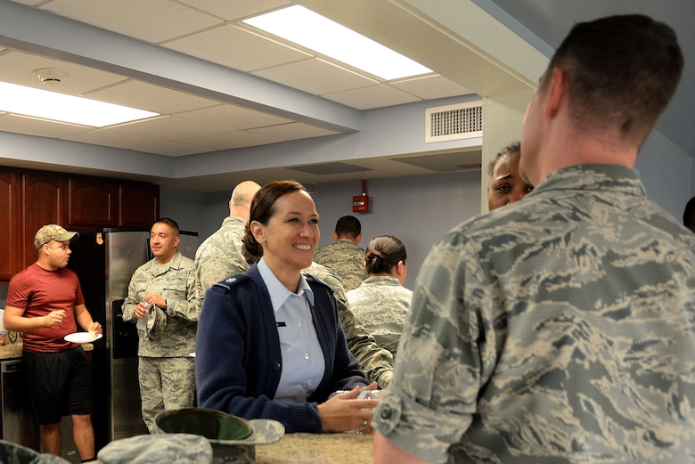 Keesler leadership and Airmen enjoy refreshments during the Haven reopening Dec. 21, 2017, on Keesler Air Force Base, Mississippi. Keesler's private organizations came together to remodel and reopen the Haven to improve the dorm common area for Keesler's dorm residents. (U.S. Air Force photo by Airman 1st Class Suzanna Plotnikov)
